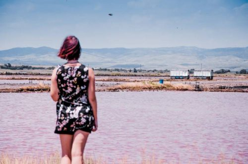 woman looking over pink lake in Burgas, Bulgaria
