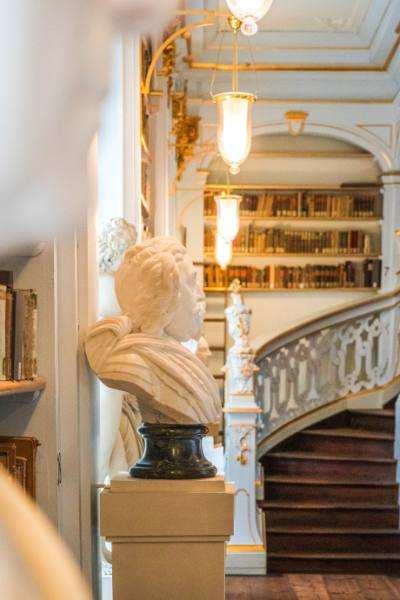 white busts and winding staircase with golden ornaments