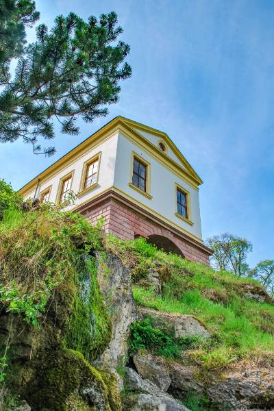 beautiful historic house on top of a rock with a blue sky